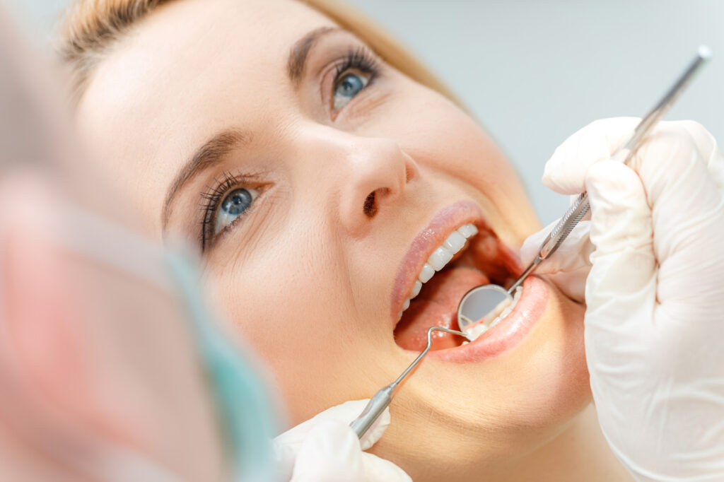 A woman getting a dental cleaning in Lexington, SC