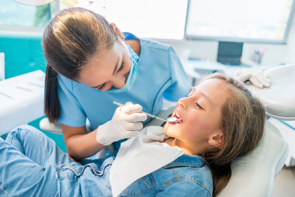 pediatric dentist working on a youg girl
